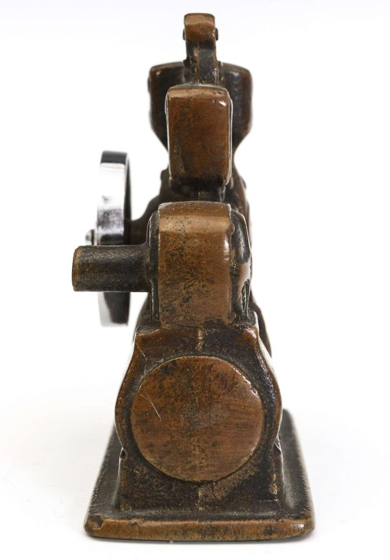 A LIPMAN FIGURAL ENGINE ADVERTISING PAPERWEIGHT - 9