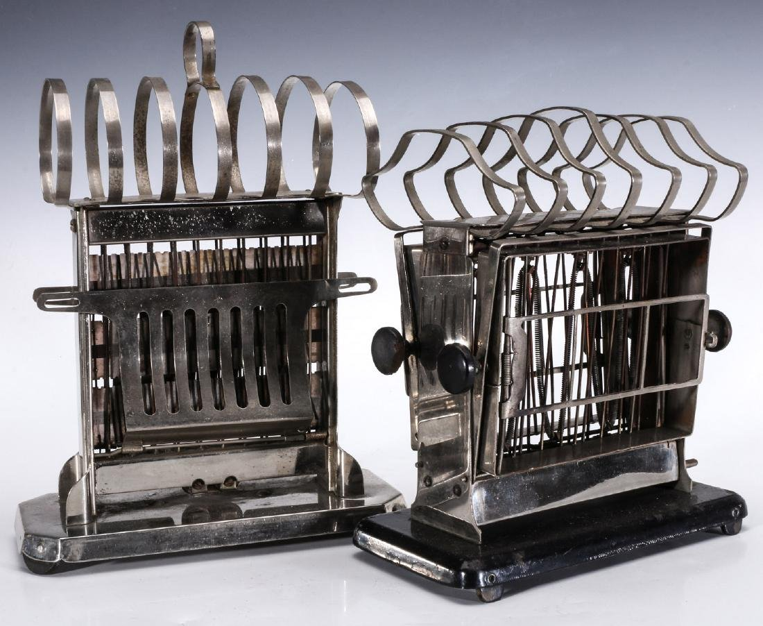 TWO EARLY ELECTRIC TOASTERS WITH UPPER TOAST RACKS