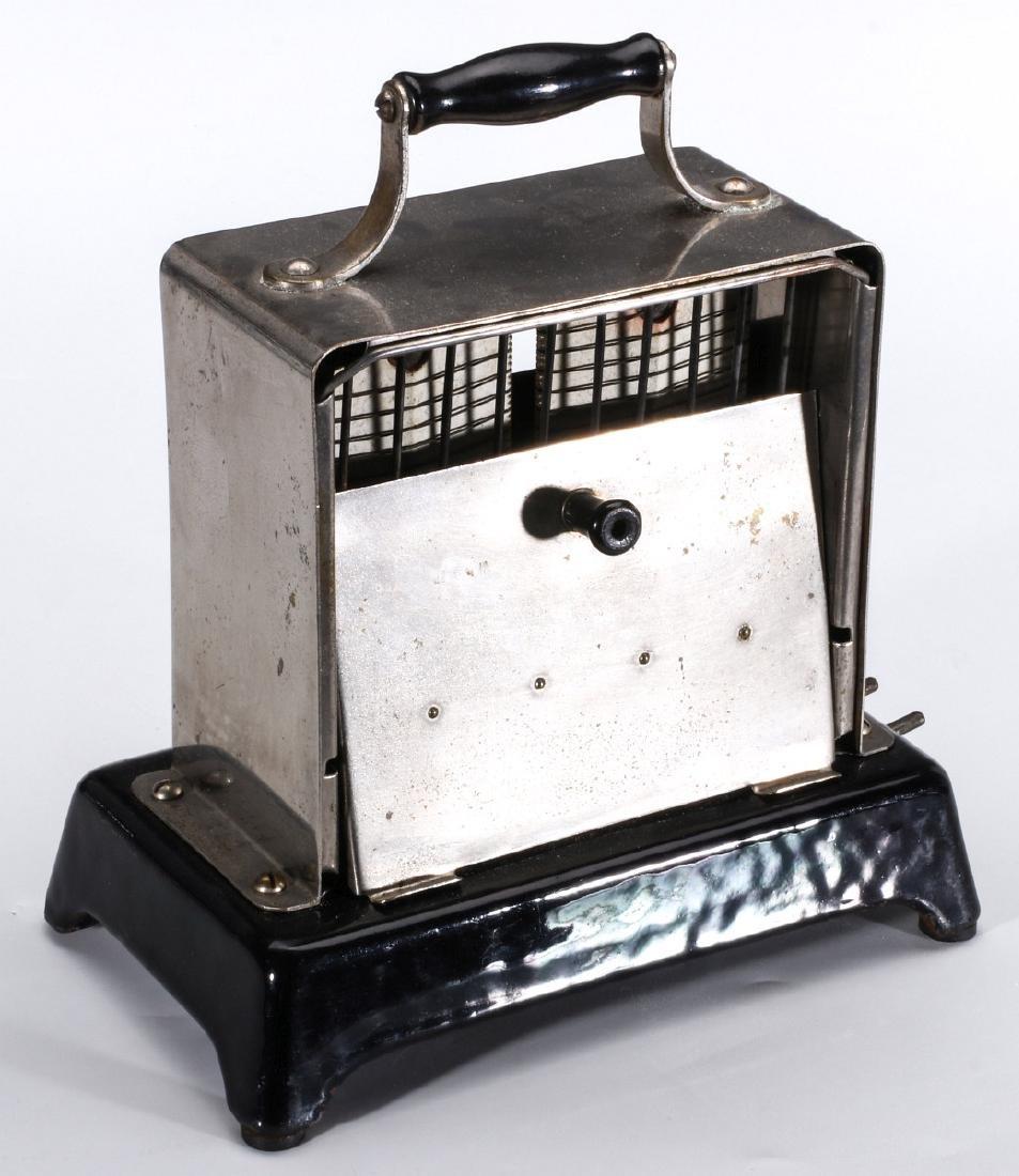 A SIMPLEX T-211 VAR 1 ELECTRIC TOASTER, CIRCA 1909