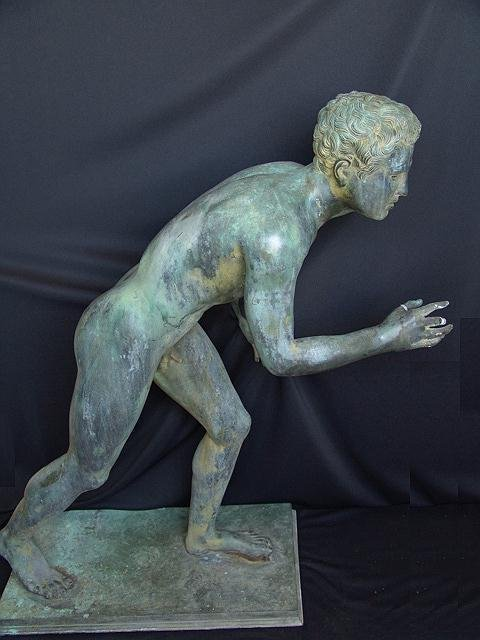 710: LIFE SIZE BRONZE OF SPRINTING YOUNG MAN, AFTER THE