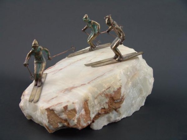 1010: CURTIS JERE' SCULPTURE WITH SNOW SKIERS