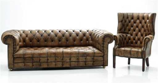 A VINTAGE LEATHER CHESTERFIELD SOFA AND WING BACK