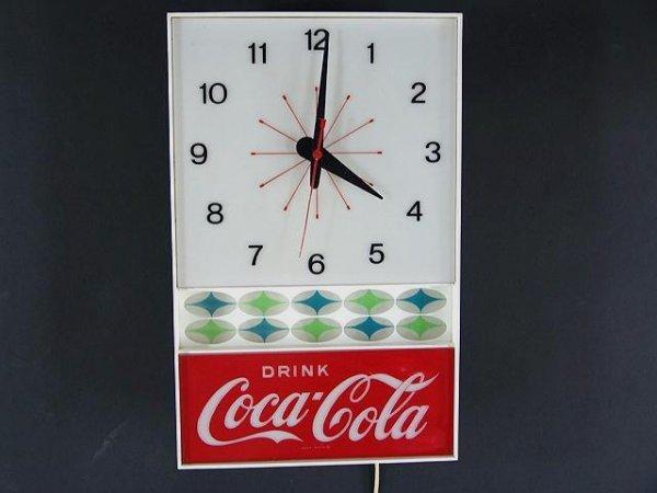 2502: 1960'S COCA-COLA STAR BURST CLOCK