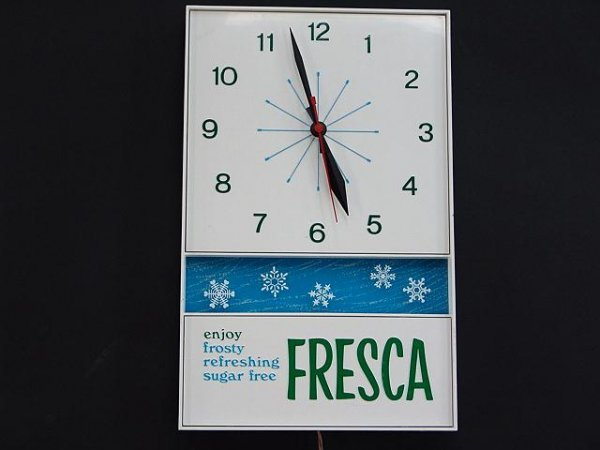 2510: 1960'S PLASTIC FRESCA CLOCK
