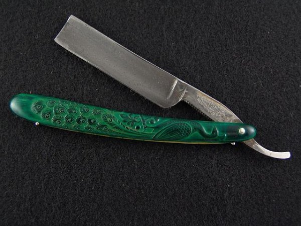 2007: GREEN PEACOCK FANCY STAINED CELLULOID RAZOR STRAI