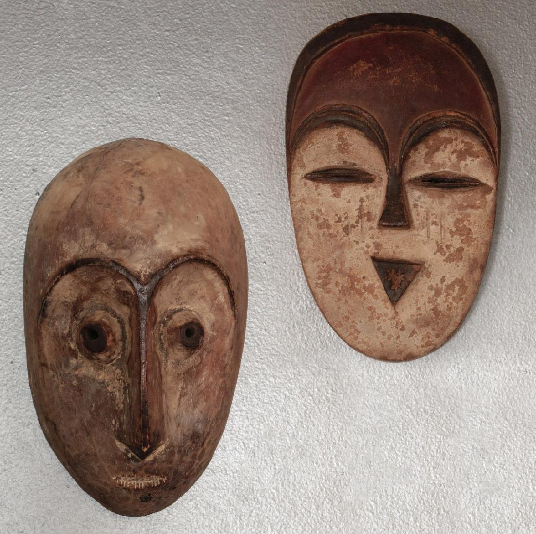 TWO CARVED AND PAINTED AFRICAN MASKS