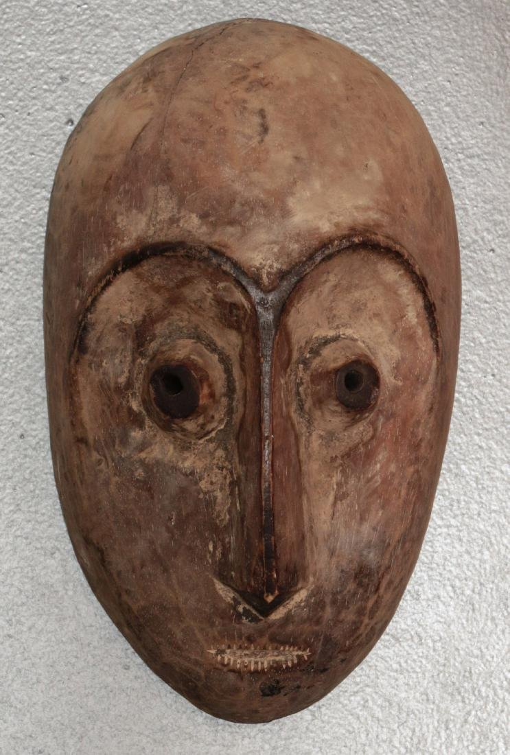 TWO CARVED AND PAINTED AFRICAN MASKS - 2