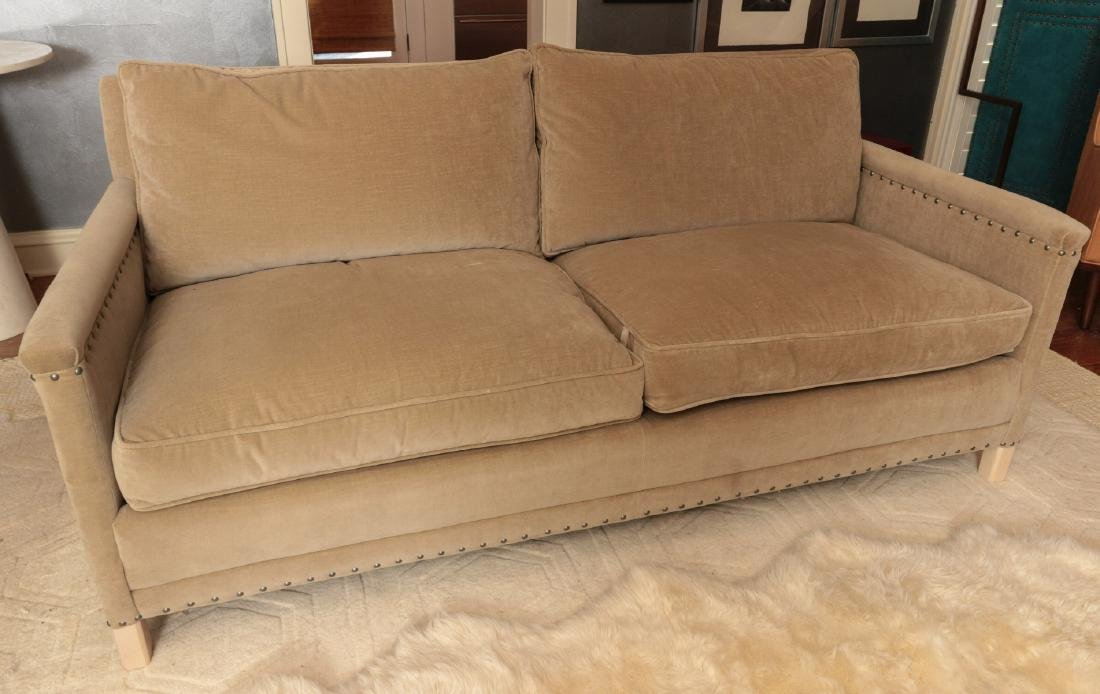 A TWO CUSHION SOFA WITH TACK HEADS