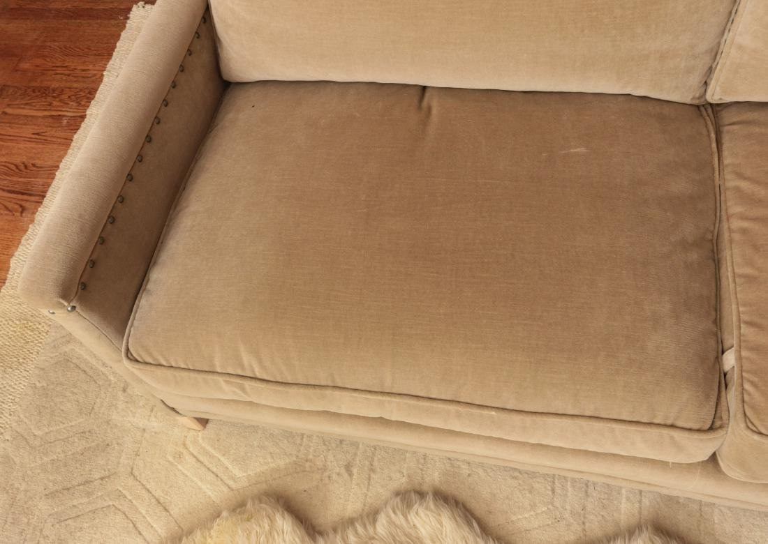 A TWO CUSHION SOFA WITH TACK HEADS - 2
