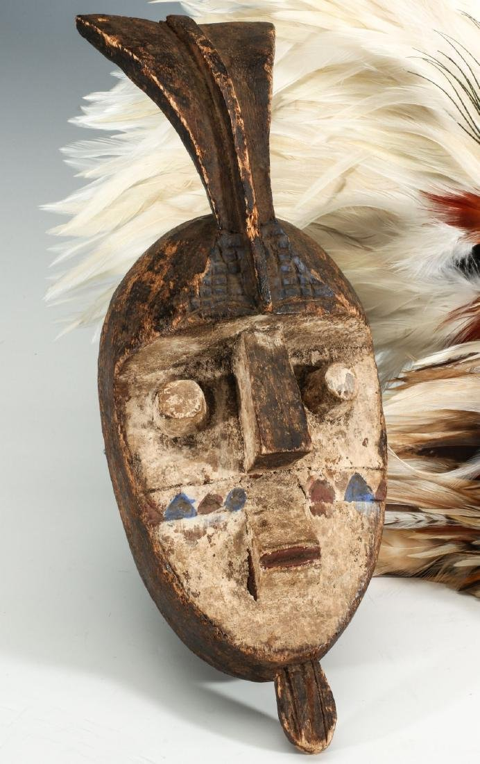 A CARVED WOOD AFRICAN MASK, PLUS FEATHERED MASKS - 2