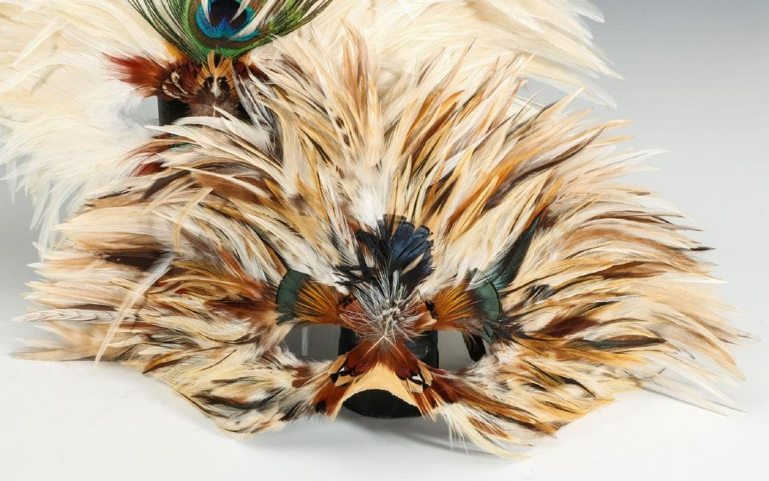 A CARVED WOOD AFRICAN MASK, PLUS FEATHERED MASKS - 3