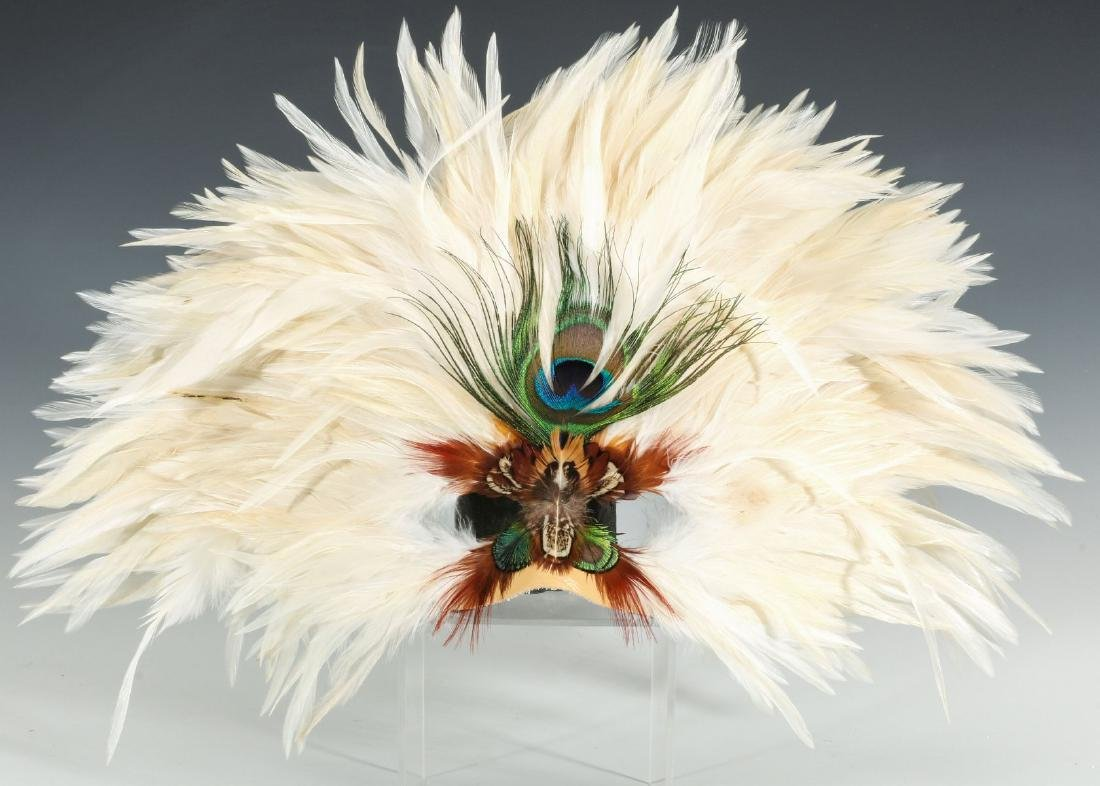A CARVED WOOD AFRICAN MASK, PLUS FEATHERED MASKS - 4