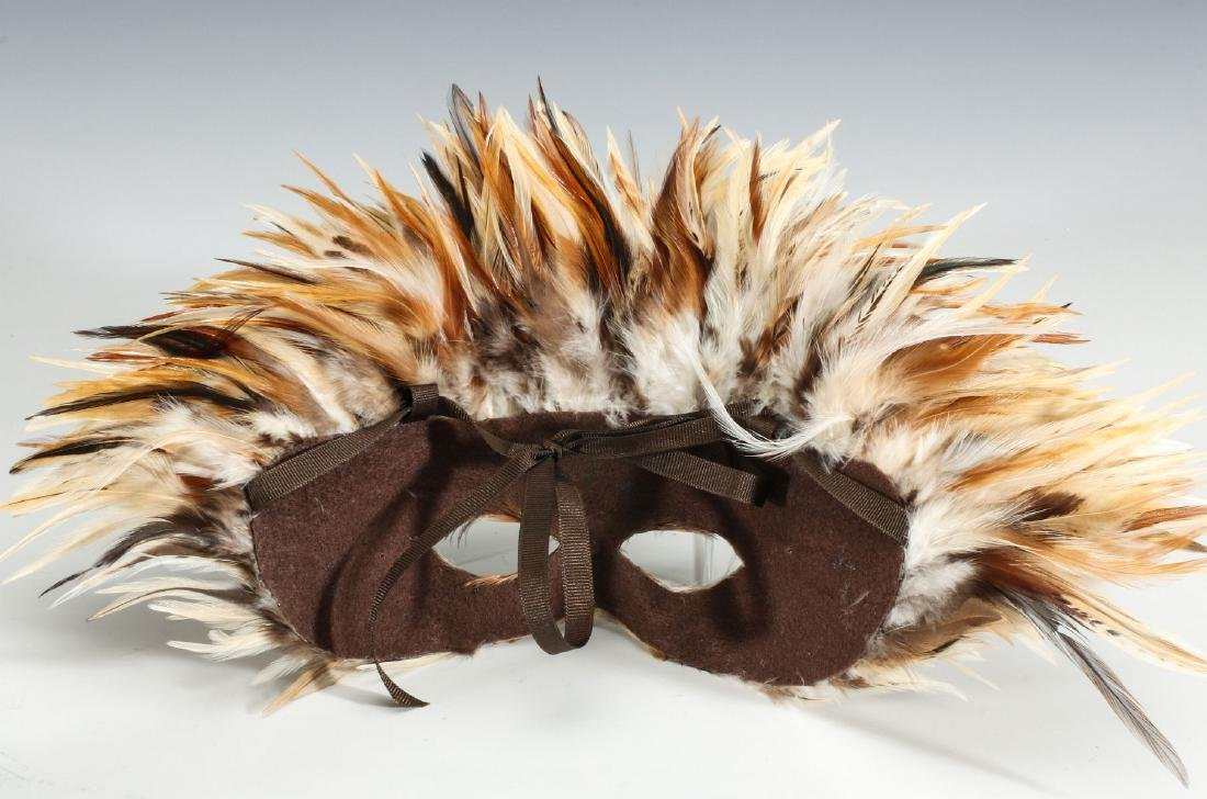 A CARVED WOOD AFRICAN MASK, PLUS FEATHERED MASKS - 6