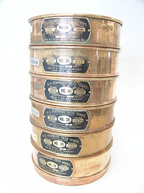 16: STACKING SERIES OF POLISHED BRASS MESH SIEVES