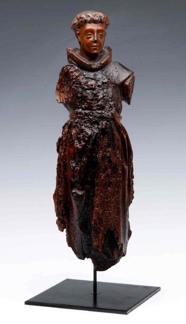 A 17TH CENTURY FLEMISH CARVED WOOD FIGURE OF MONK