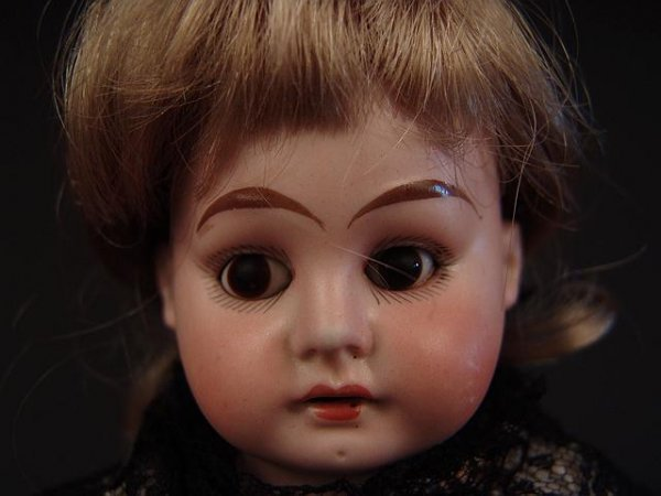4016: ANTIQUE BISQUE HEAD DOLL WITH HORSESHOE MARK