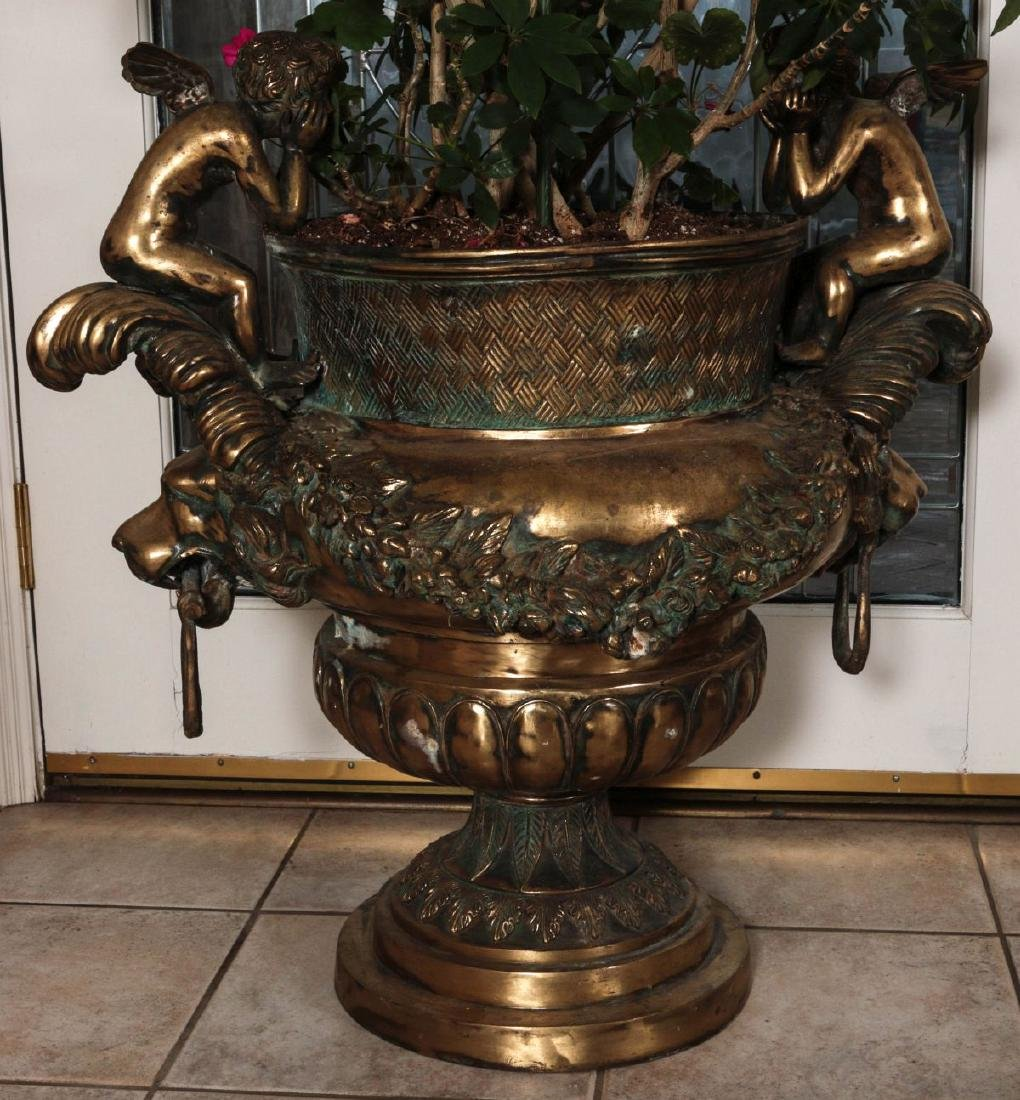 A PAIR MASSIVE BRONZE URNS WITH CHERUBS AND LIONS