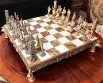 AN ELABORATE CHESS SET ON ONYX AND MARBLE BOARD