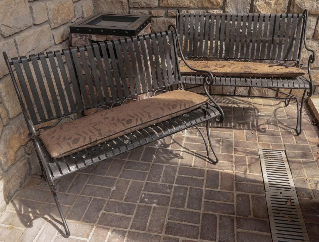 A PAIR OF STRAPWORK IRON PATIO BENCHES