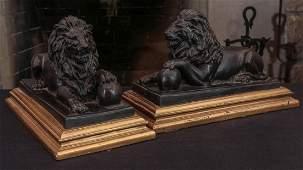 A PAIR OF DECORATIVE BRONZE LION FIGURES