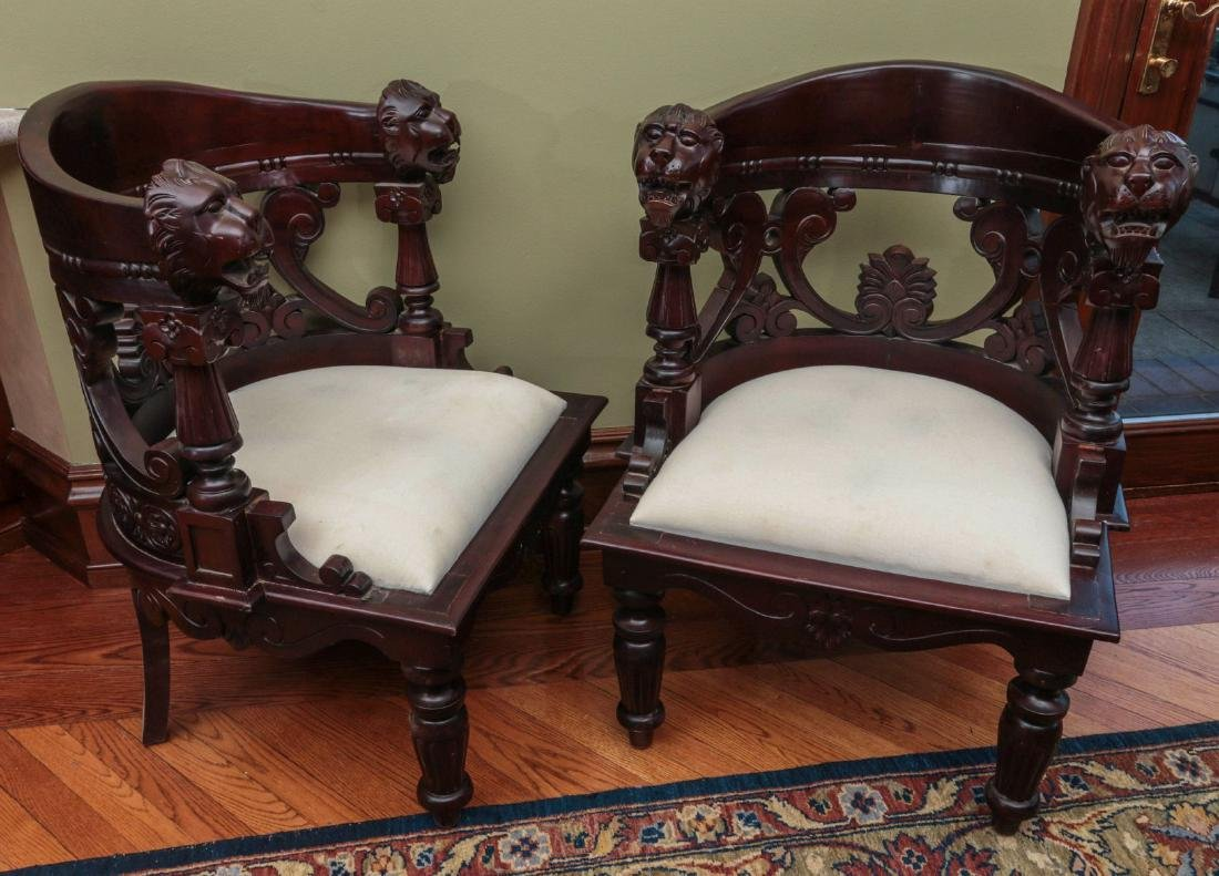 A PAIR CARVED CHAIRS WITH LARGE LION'S HEADS