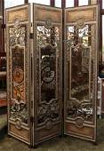 A THREE PANEL FOLDING SCREEN WITH WROUGHT IRON