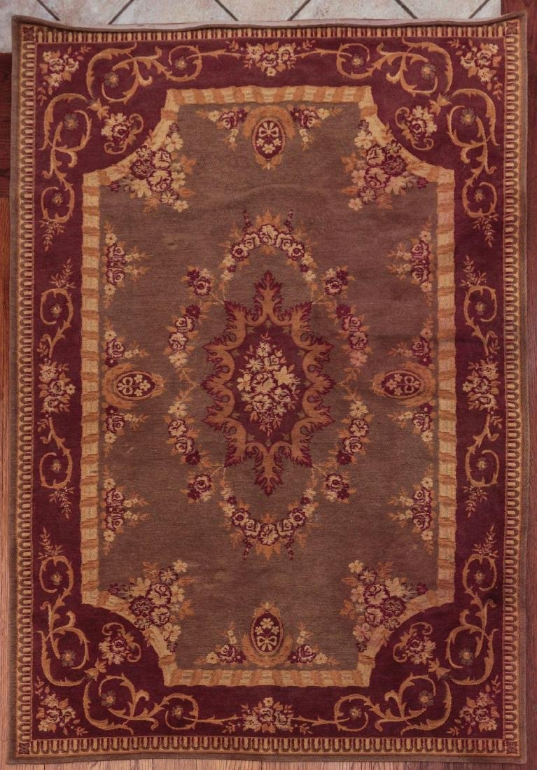 A MACHINE MADE CHENILLE TYPE AREA RUG