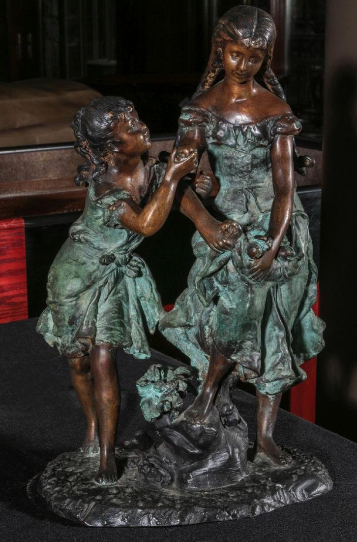 A LATE 20TH C BRONZE SCULPTURE WITH YOUNG LADIES