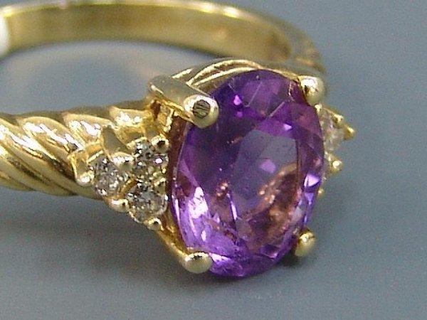 21: LADIES' 10K YEL GOLD AMETHYST & DIAMOND RING