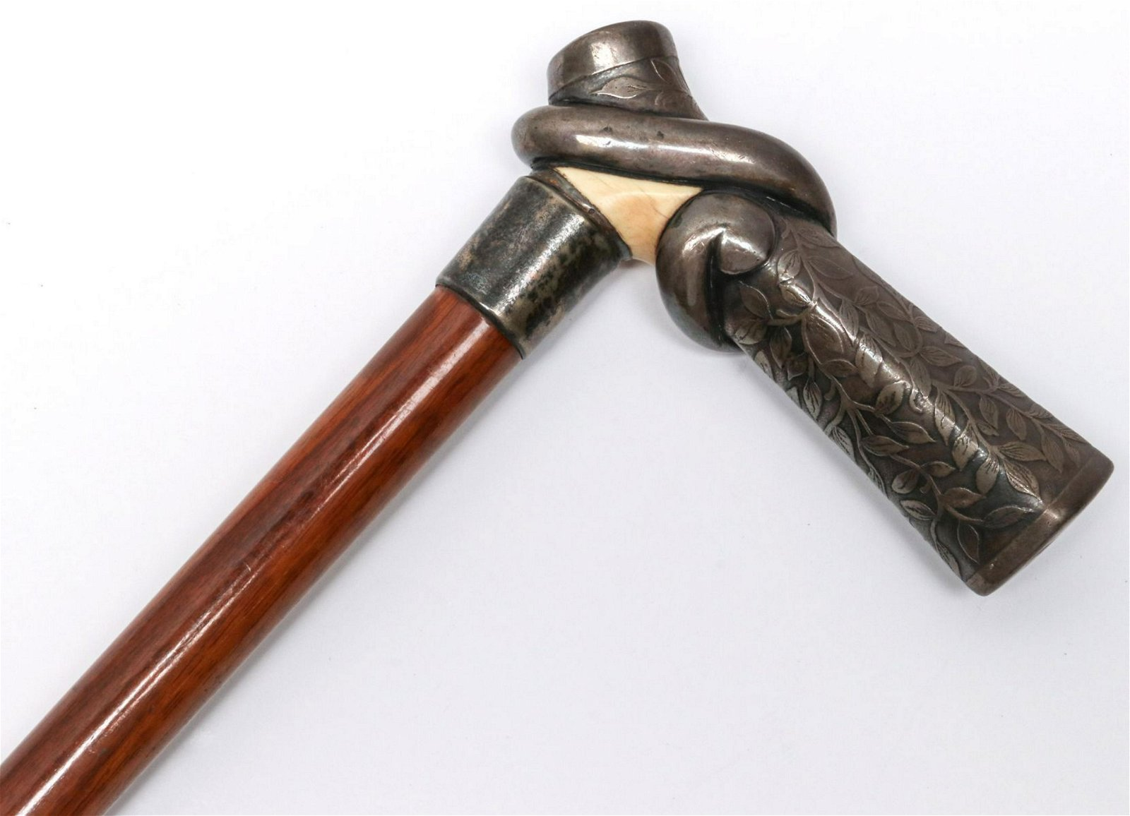 A ANTIQUE CANE WITH STERLING AND OTHER HANDLE, 1905