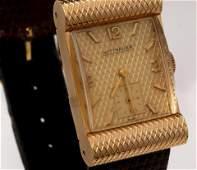 A VINTAGE 14K GOLD WITTNAUER WRISTWATCH IN BOX