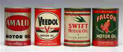 A GROUP OF VINTAGE MOTOR OIL CANS WITH ADVERTISING