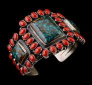 A COLORFUL KIRK SMITH CORAL AND TURQUOISE CUFF