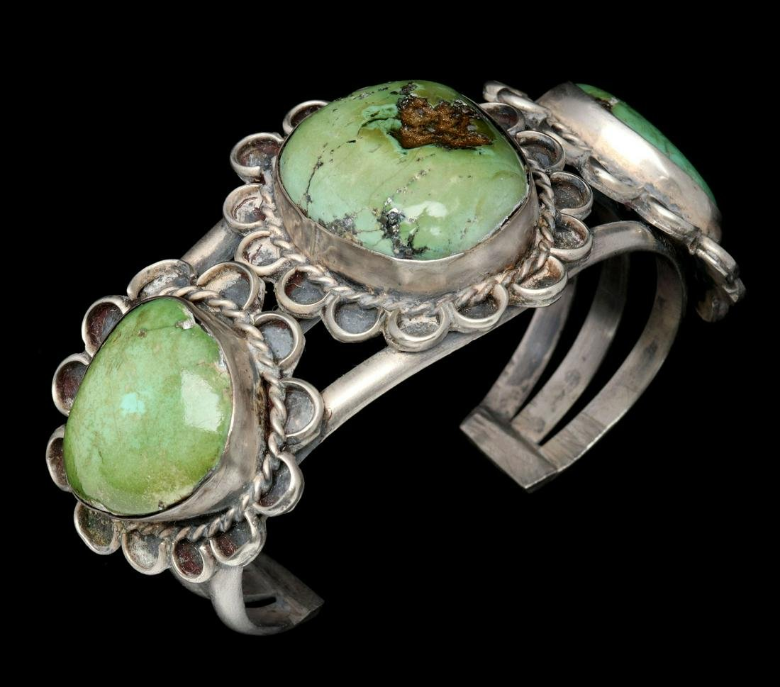 A NAVAJO CUFF BRACELET WITH AJAX TURQUOISE STONES