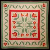 A GOOD 1930s HAND STITCHED APPLIQUE QUILT WITH TULIPS