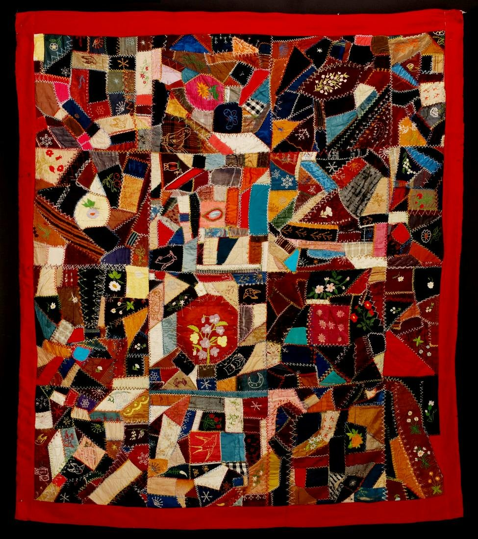 A HEAVILY EMBROIDERED LATE 19TH C. AMERICAN CRAZY QUILT