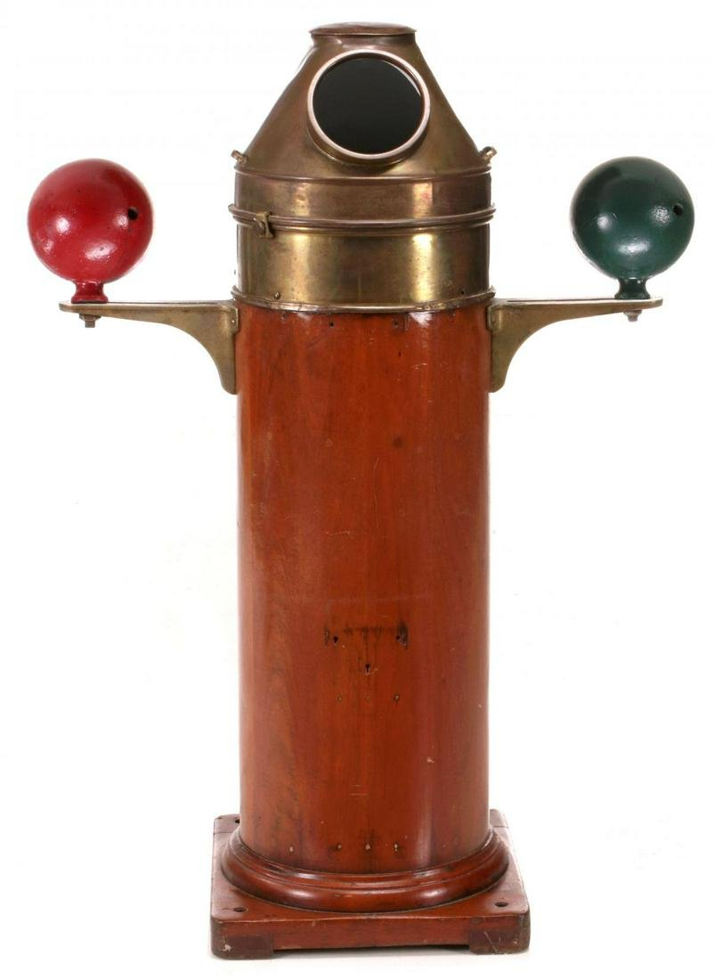 A LIONEL BRASS AND MAHOGANY FLOOR MOUNT SHIP'S BINNACLE
