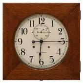 A SETH THOMAS 'HUDSON' OAK CASE GALLERY CLOCK