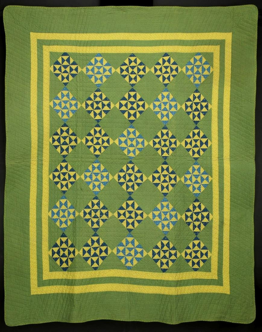 AN ANTIQUE 'BROKEN DISHES' PATTERN CALICO QUILT
