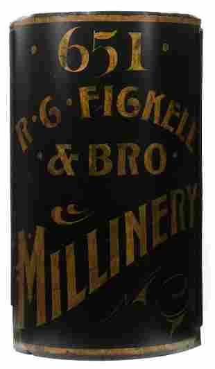 A 19TH CENTURY CORNER SIGN FOR R.C. FICKELL MILLINERY