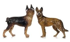 TWO HUBLEY CAST IRON DOG DOOR STOPS
