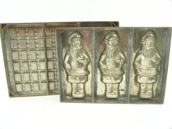416: TWO ANTIQUE CHOCOLATE MOLDS INCL SANTA