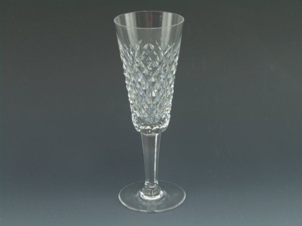 423: EIGHT FINE WATERFORD CRYSTAL FLUTES