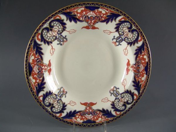 1018: FOUR LATER ROYAL CROWN DERBY SOUP PLATES