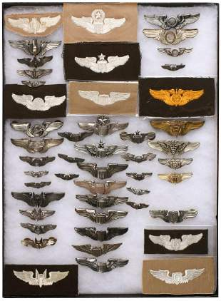 A COLLECTION OF 40 VARIOUS WWII AVIATION WINGS
