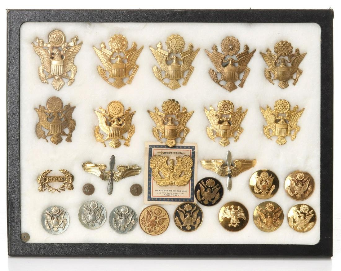 A COLLECTION OF WWII ARMY AND NAVY INSIGNIA AND PINS