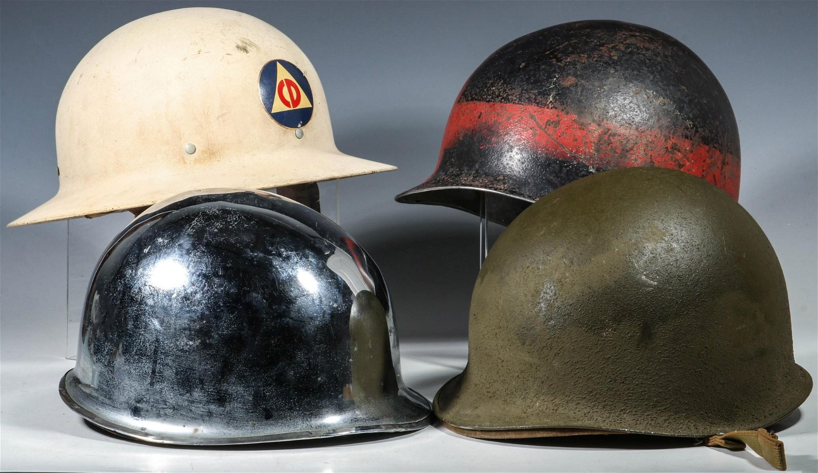 A COLLECTION OF US WWII AND OTHER HELMETS