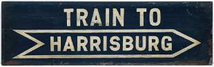 A PAINTED METAL GATE SIGN FOR THE TRAIN TO HARRISBURG