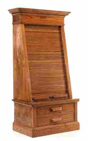 A GOOD OAK TAPERING ROLL FRONT TICKET CABINET C. 1880