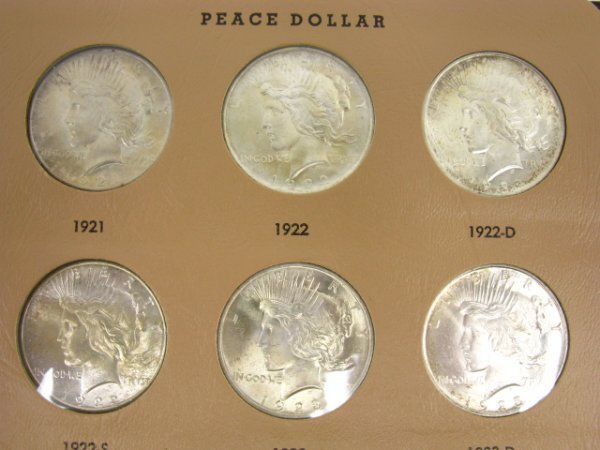 701: ALBUM OF 19 UNCIRCULATED PEACE DOLLARS